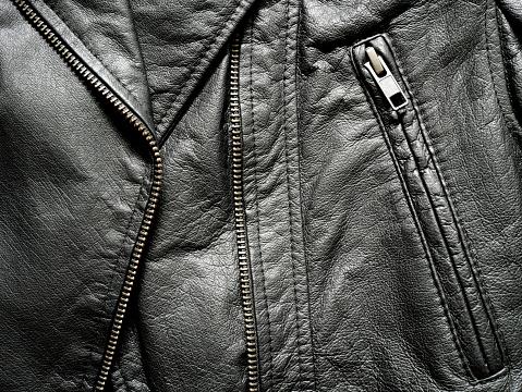 672414164 istock photo Close up black leather jacket 672414164