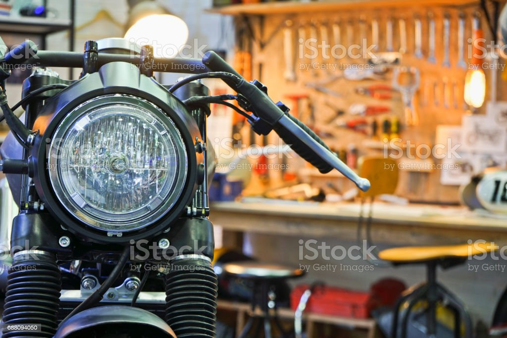 Close up Black Motorbike in Motorbike Garage. stock photo