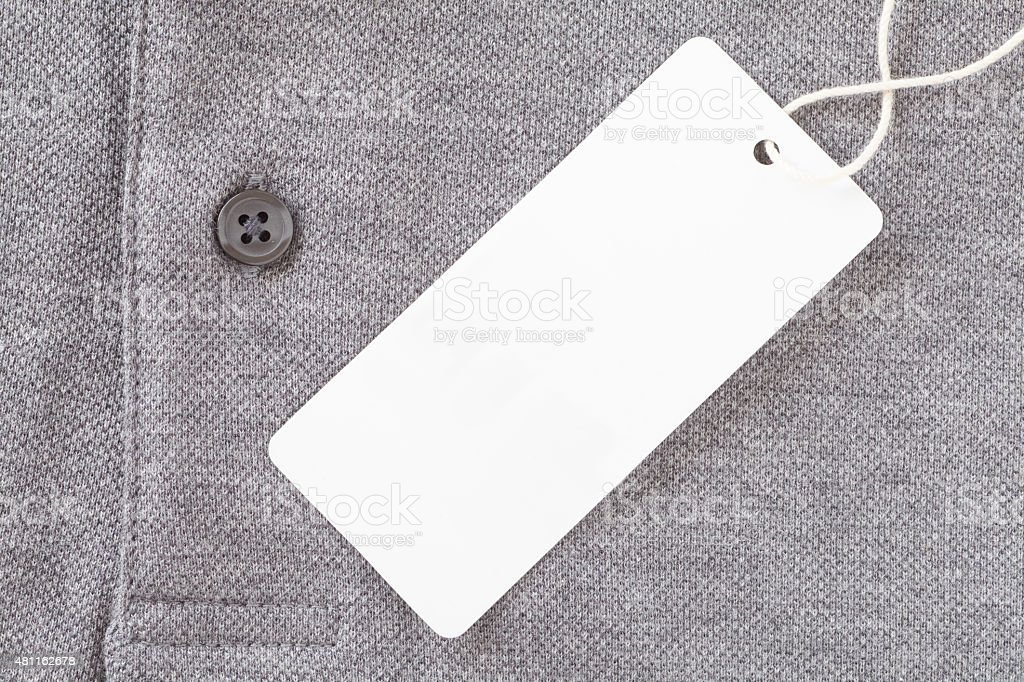 Close - up Blank tag label on grey shirt stock photo