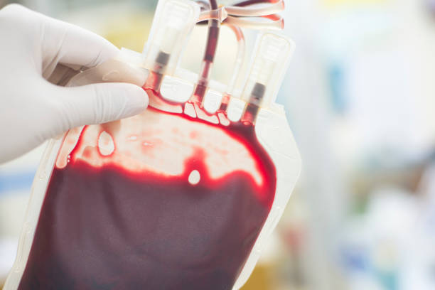 close up blood bag in laboratory medical concept. - group of people стоковые фото и изображения