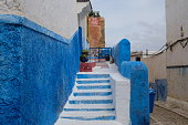istock close up blue and white walls and stairs of chefchaouen in Morocco Africa. 1169275130