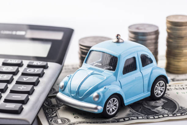 Close up blue car with calculator and coin, Auto loan