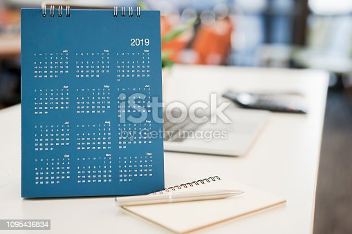istock close up blue color calendar 2019  standing on white table at office room for make appointment or remind important date , workplace with object concept 1095436834