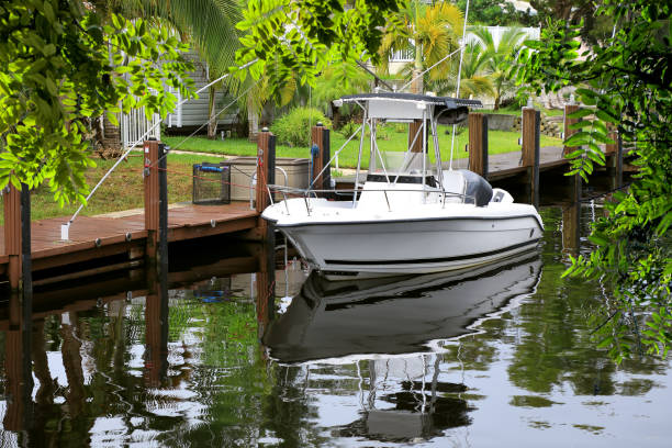 Close up boat at dock on canal in Florida stock photo