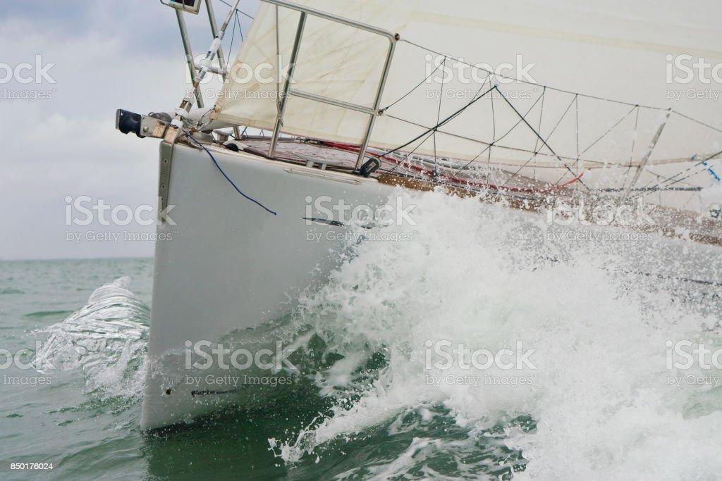 Close up bow and wave of a sailing boat, sail boat or yacht at sea - foto stock