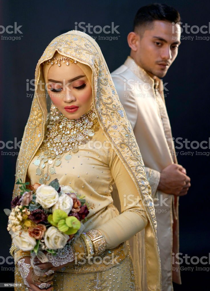 05882d098f Close up Bride and groom, Indonesian Wedding Dress royalty-free stock photo