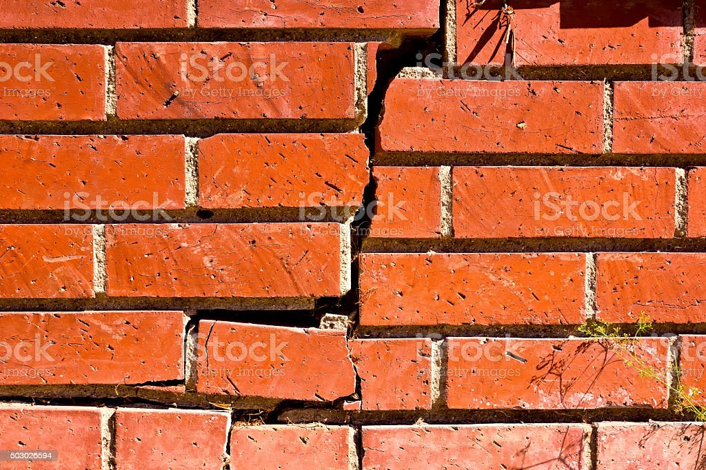 Close Up Broken Brick Wall stock photo