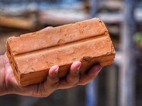 Image result for brick in hand