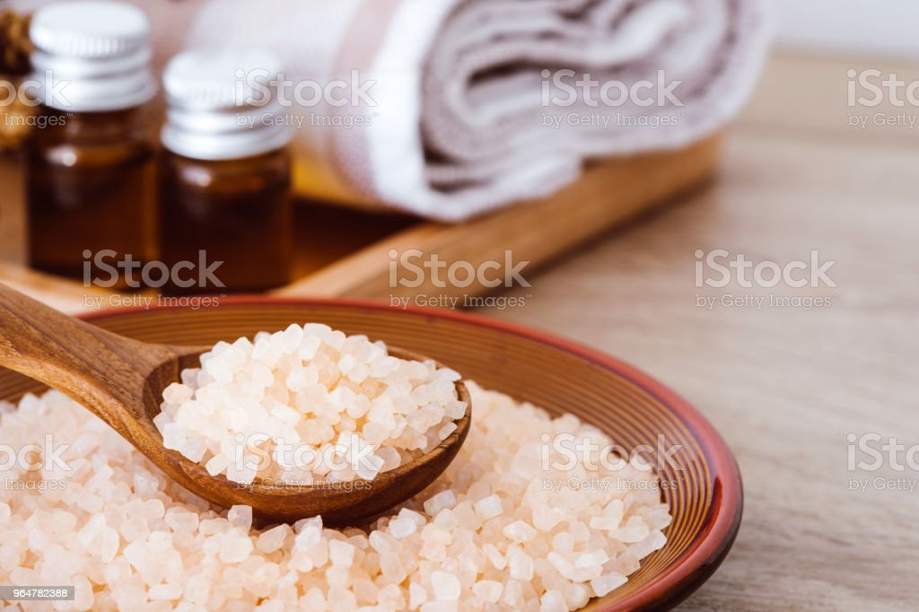 Close up brown organic Himalayan rock salt spa and cinnamon essential oil aroma set on  table , healthy spa relaxation concept royalty-free stock photo