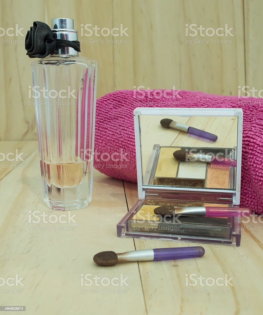 Close up brush with eyeshadow palette and perfume stock photo