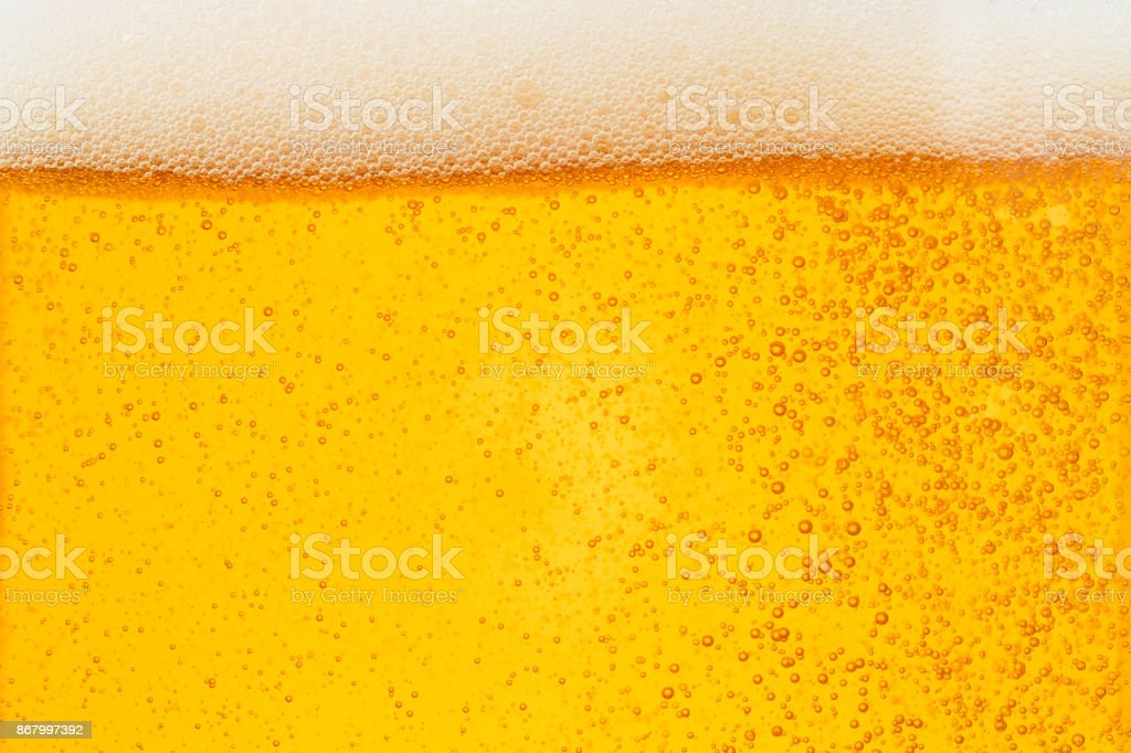 Close up Bubble froth of beer in glass or mug for background on top view stock photo