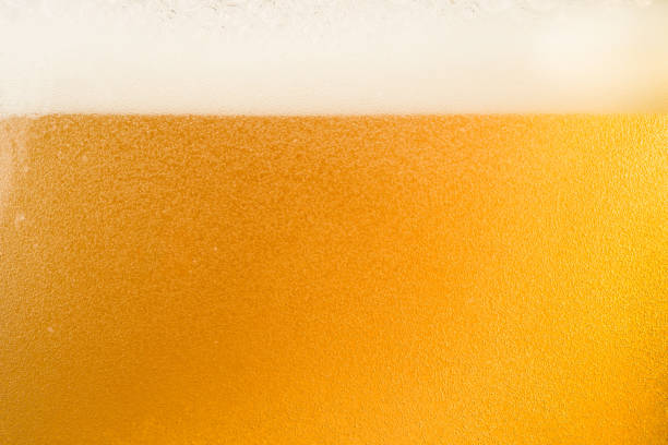 Close up bubble of beer in glass for background stock photo