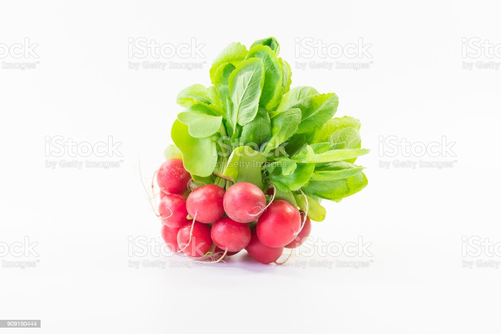 close up bunch of fresh small red purple radishes on isolated white background stock photo