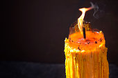 Close up yellow burning candle from Buddhist temple