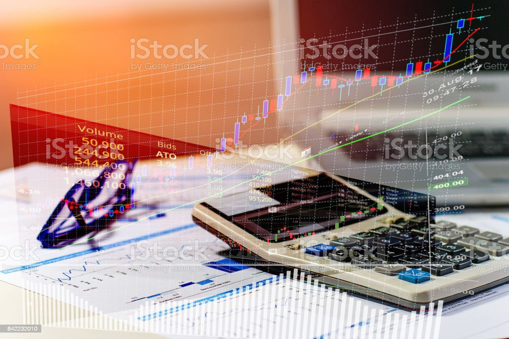 close up business concept calculator glasses and latop on summary