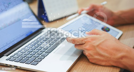 Close up business man hand hold tablet for thinking about stock market graph trading with statistic chart infographic concept