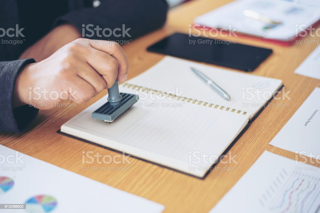 close up , business man hand stamping   rubber Stamp on a documents - business concept stock photo