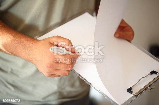 896826068 istock photo close up Business man Hands with pen writing on paper 895769072