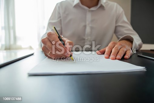659493026 istock photo Close up business man signing contract making a deal, classic business. 1069137488