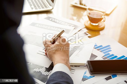659493026 istock photo Close up business man signing contract making a deal, classic business. 1156283168