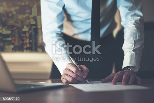 istock Close up business man signing contract 699827170
