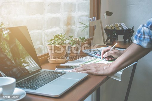 istock Close up  Business man working at office holding a pen with docu 876810132