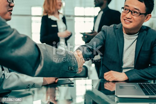 541976840 istock photo close up. business partners confirm the transaction with a firm 1223521082