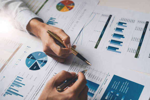 Close up Business people meeting to discuss the situation on the market. Business Financial Concept Close up Business people meeting to discuss the situation on the market. Business Financial Concept plan document stock pictures, royalty-free photos & images