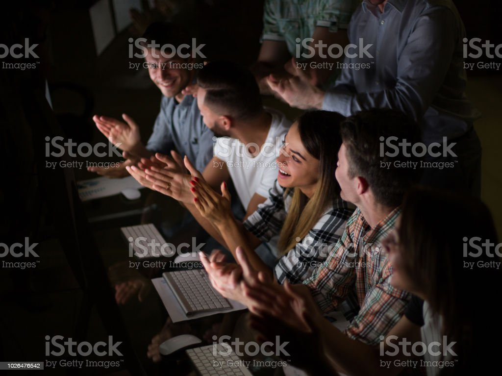 close up. business team applauds, sitting at the Desk stock photo