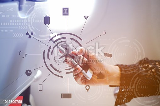 istock close up business woman hand holding smartphone at window seat inside aircraft with symbol of travel icon for transportation concept 1019309758