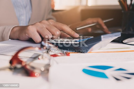 897852992istockphoto Close up Businessman and partner using calculator and laptop for calculating finance, tax, accounting, statistics and analytic research concept 1069166680