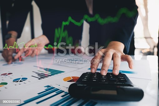 istock Close up Businessman and partner using calculator for calculating financial document, tax, accounting, statistics and analytic research concept 990993590