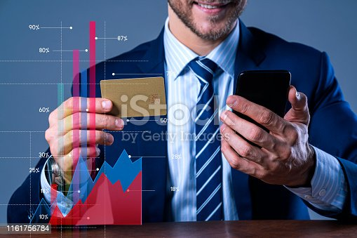 close up businessman formal suit hand hold smartphone and credit card business online and shopping online ideas concept