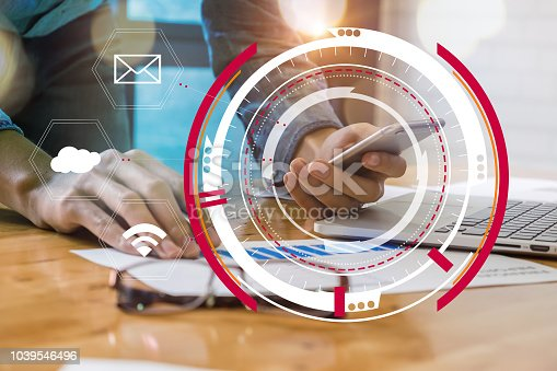istock Close up Businessman hand holding cell phone and pointing at financial paperwork with financial network diagram. 1039546496