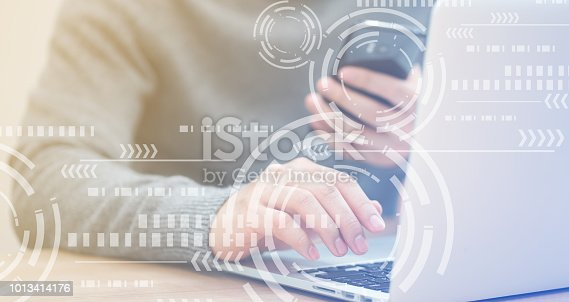 istock Close up businessman hand typing or working on laptop and smart phone for programming about cyber security with virtual interface protection circle wheel interface, advance future technology concept 1013414176