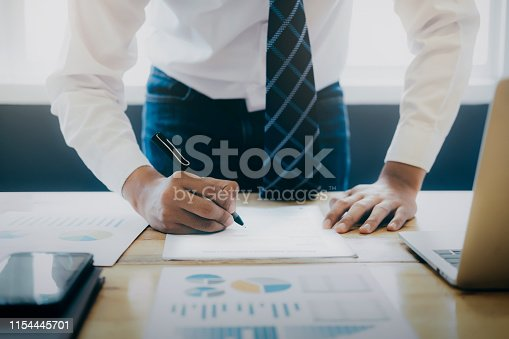 659493026 istock photo Close up businessman signing contract making a deal. 1154445701