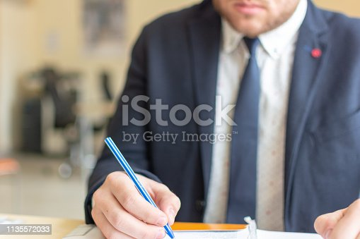 659493026 istock photo Close up businessman signing documents. Business man signing contract making a deal, classic business. 1135572033