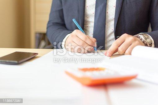 659493026 istock photo Close up businessman signing documents. Business man signing contract making a deal, classic business. 1135572051