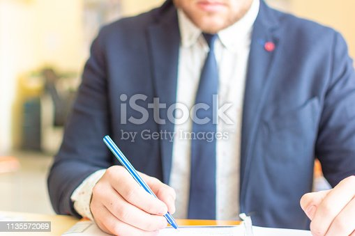 659493026 istock photo Close up businessman signing documents. Business man signing contract making a deal, classic business. 1135572069