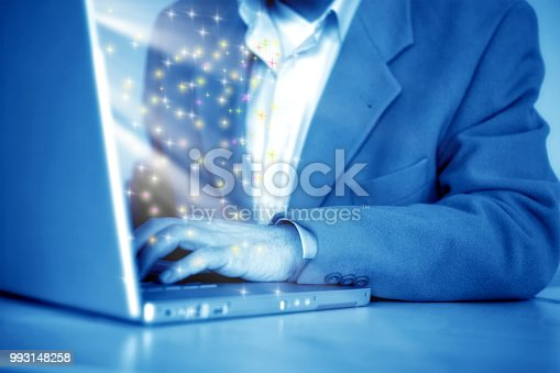 879813798istockphoto Close up businessman working on a laptop 993148258