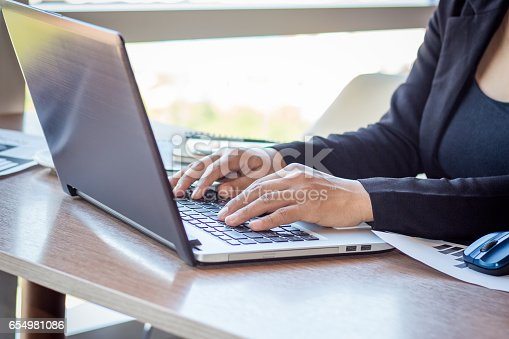 658588384istockphoto Close Up businessmen working at a coffee shop 654981086