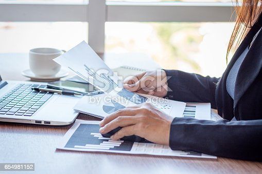 658588384istockphoto Close Up businessmen working at a coffee shop 654981152