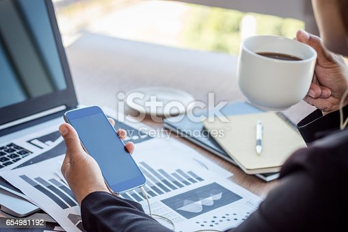658588384istockphoto Close Up businessmen working at a coffee shop 654981192