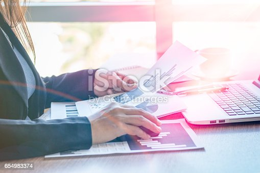 658588384istockphoto Close Up businessmen working at a coffee shop 654983374