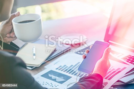 658588384istockphoto Close Up businessmen working at a coffee shop 654983444