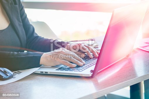 istock Close Up businessmen working at a coffee shop 654983508