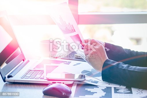 658588384istockphoto Close Up businessmen working at a coffee shop 657861530