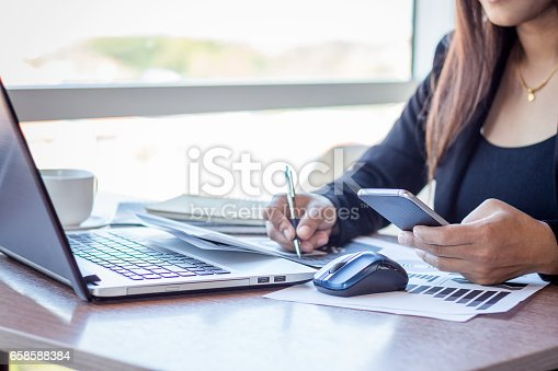 istock Close Up businessmen working at a coffee shop 658588384