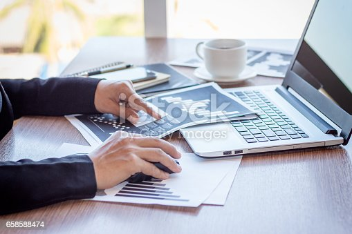 658588384istockphoto Close Up businessmen working at a coffee shop 658588474