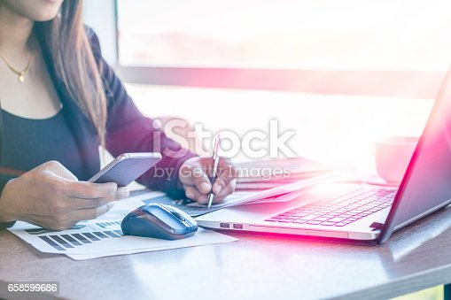 658588384istockphoto Close Up businessmen working at a coffee shop 658599686